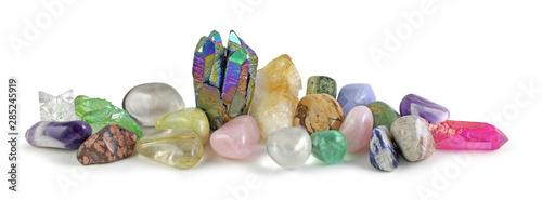 Fototapeta Row of multicoloured Healing Crystals Background Banner - Rainbow Aura Quartz and Citrine surrounded by various tumbled healing stones and terminated quartz with space for copy obraz