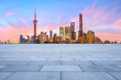 Shanghai skyline and modern buildings with empty square floor at sunrise,China.