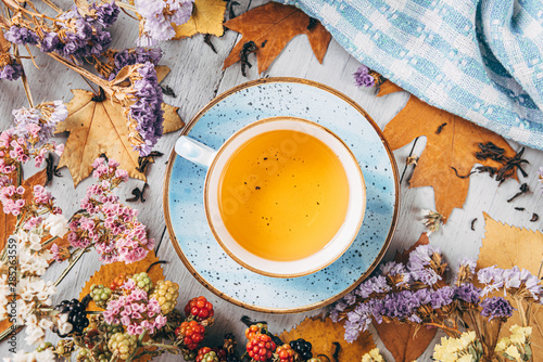 Recess Fitting Tea autumn warming tea on a wooden table with autumn tree leaves lying nearby