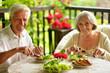 canvas print picture - Portrait of happy senior couple having diner
