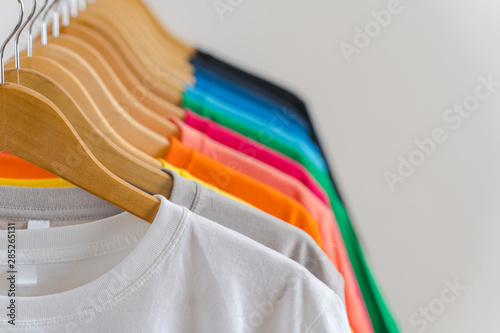 Obraz Close up of Colorful t-shirts on hangers, apparel background - fototapety do salonu