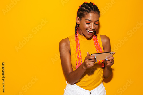 Image of beautiful african american woman with afro braids smiling and holding s Fototapet