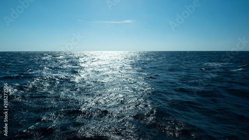 Slika na platnu Horizontal and sea water surface, Dark blue ocean water for natural background