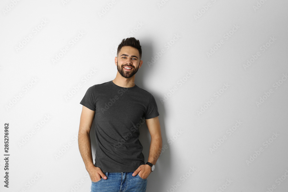 Fototapety, obrazy: Portrait of handsome smiling man isolated on white