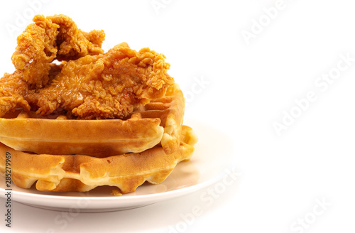 Fototapeta Pile of Chicken and Waffles Isolated on a White Background obraz