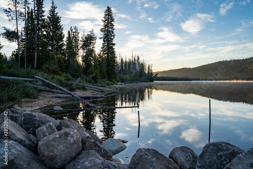 Acrylic Prints Gray traffic Beautiful sunrise at Stanley Lake in the Sawtooth Mountains of Idaho. Reflection in water with rocks in foreground