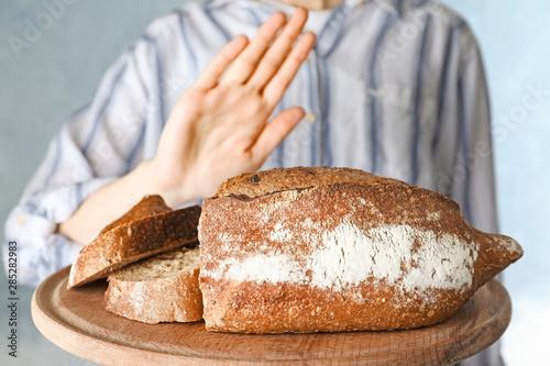 Woman refusing to eat bread, closeup. Food allergy concept Tablou Canvas