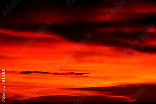 Foto auf Leinwand Ziegel sunset on last light sky silhouette cloud in evening