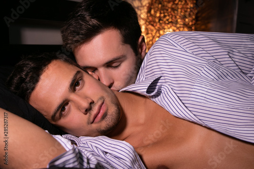 Gay men kissing and touching