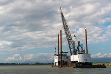 Selective Focus Of Crane On Sea