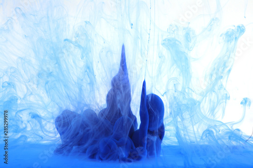 Abstract blue smoke on white background. Acrylic colors in water. Ink blot.