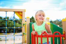 Happy Girl On The Playground.