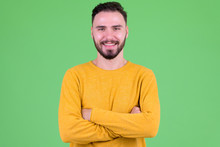 Happy Young Handsome Bearded Man Smiling With Arms Crossed