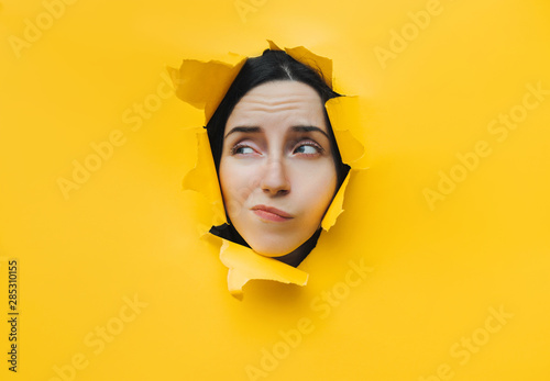 A young girl expresses a toothache with her facial expressions Fototapeta