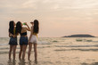 Group of Asian teenage girls having party celebrating on beach, friends happy drinking beer on beach at sea when sunset in evening. Outdoor activity friends travel holiday vacation summer concept.