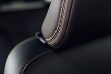 Part Of Stitched Leather Black Leather Car Interior. Modern Luxury Car Black Perforated Leather Interior. Car Leather Interior Details