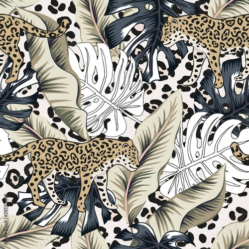 Photographie Tropical leopard, banana, monstera palm leaves, animal print background