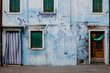 A blue house on the island of Burano in Venice