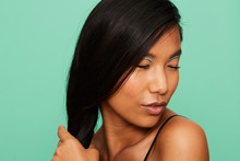 Asian Woman Portrait With Strong Hair