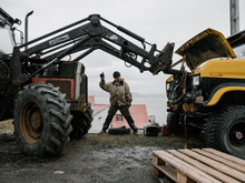 Man Fixing Car Controlling Work Of Heavy Equipment