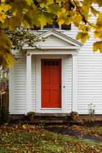 Red Door Of A Classic New England Home