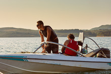 Men On A Motor Boat Preparing ...