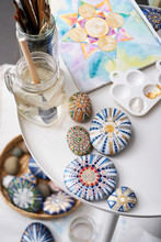 Close-up Of Mandala Painted Stones. Painting Scene At Home, Empty Scene.