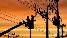 Silhouette Two Electricians Wi...