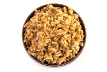 Cajun Dirty Rice In A Wooden Bowl On A White Background