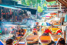 Damnoen Saduak Floating Market, Tourists Visiting By Boat, Located In Bangkok, Thailand.