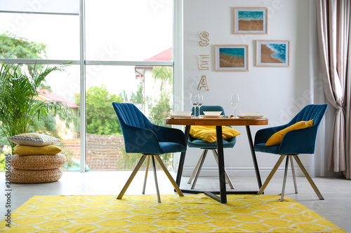 Cuadros en Lienzo Modern dining room interior with served table and chairs