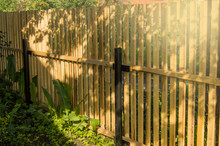 Rustic New Wooden Fence With B...