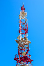 TV And Radio Broadcasting Tower And Also Devices Of Transfer Of Mobile Communication Against The Background Of The Clear Blue Sky
