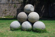 A Pile Of Old Stone Cannonball...