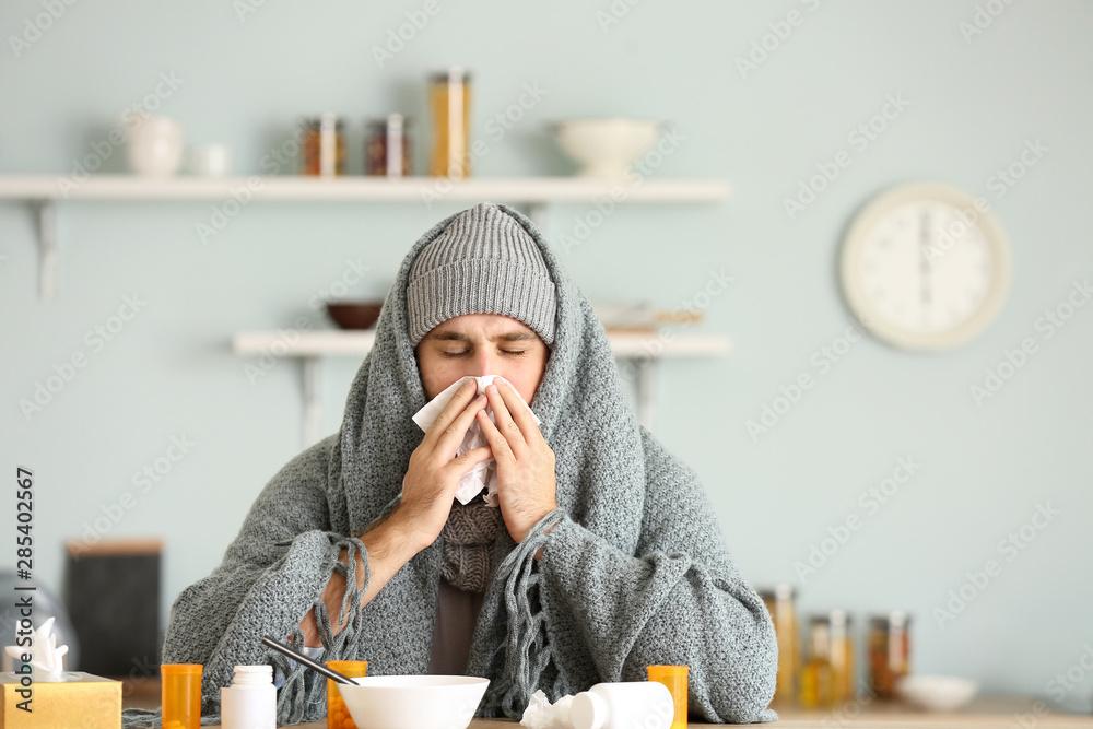 Fototapety, obrazy: Sick man sitting at kitchen table