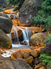 Smooth Flowing Water Falling Over Rocks