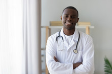 Male African American Professional Young Doctor Looking At Camera, Portrait