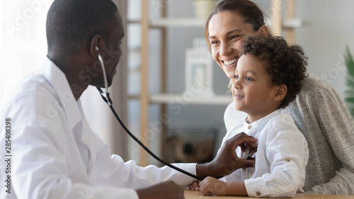 Stampa su Tela  African male pediatrician hold stethoscope exam child boy patient