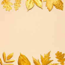 Flat Lay Creative Autumn Composition. Frame From Golden Leaves On Beige Background Top View Copy Space. Fall Concept. Autumn Background. Minimal Concept Idea, Floral Design. Square Format