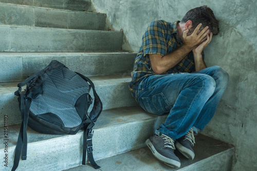 Campaign vs homophobia with young sad and depressed college student man sitting Fototapeta