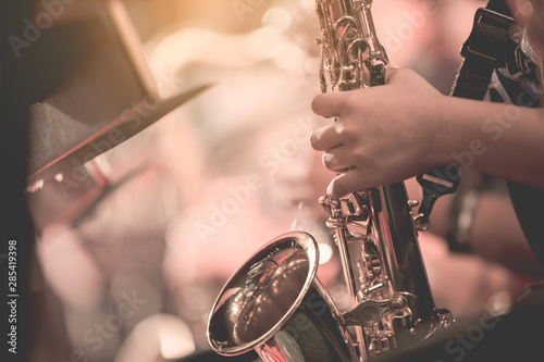 Obraz na plátně Musical instruments ,Saxophone Player hands Saxophonist playing jazz music