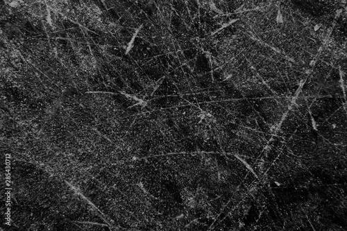 Schlittschuhspuren auf schwarzer Eis Öberfläche Canvas Print