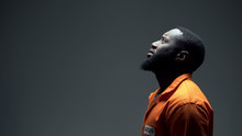 Afro-american Imprisoned Male Praying Looking Up At Light, Talking To God, Faith