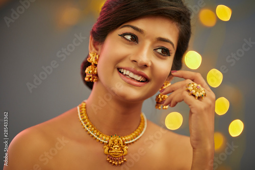 Beautiful Indian young women portrait with jewelry Wallpaper Mural