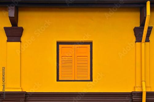 Yellow shuttered window Canvas Print