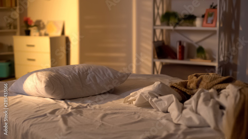 Obraz Messy bed, white pillow with blanket lying on bed unmade, oversleeping concept - fototapety do salonu