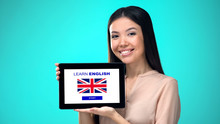 Female Holding Tablet With Learn British English Application, Ready To Start