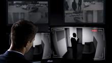 Male Security Guard Watching Bandit Brake In Building, CCTV Footage, Crime Scene
