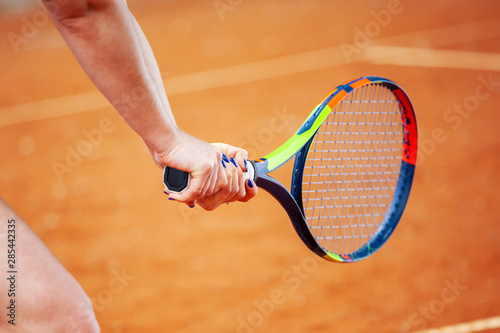 Tennis player hitting two-handed backhand. Wallpaper Mural