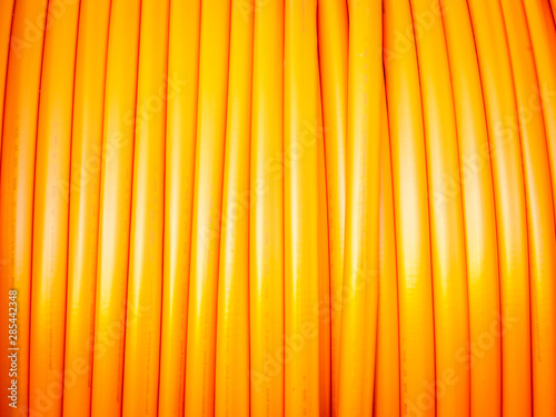 Fotomural  communication cable in orange on a roll